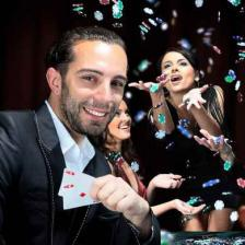 Man winning at blackjack with woman in the background.